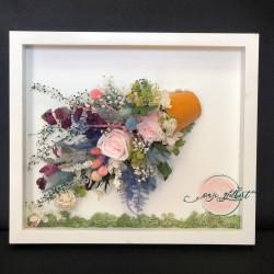 Kornizë me lule të balsamosura